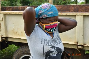 The Water Project:  Margaret Mbone Wearing Her Mask