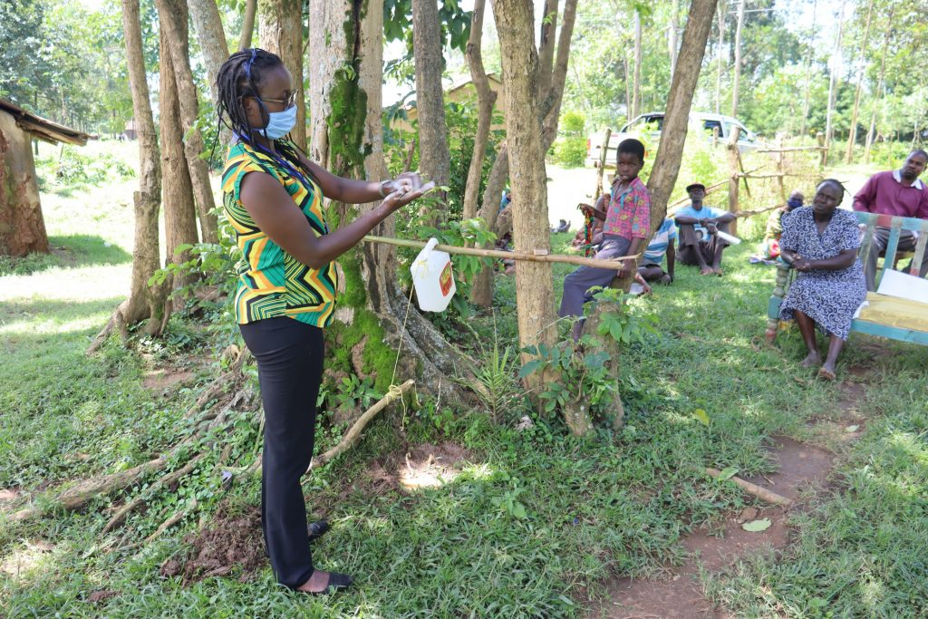 The Water Project : covid19-kenya4370-ms-olivia-demonstrating-the-ten-steps-of-handwashing