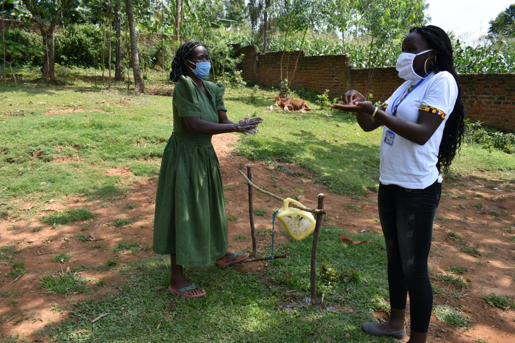 The Water Project : covid19-kenya4411a-mama-next-to-ms-patricia-learning-how-to-wash-her-hands