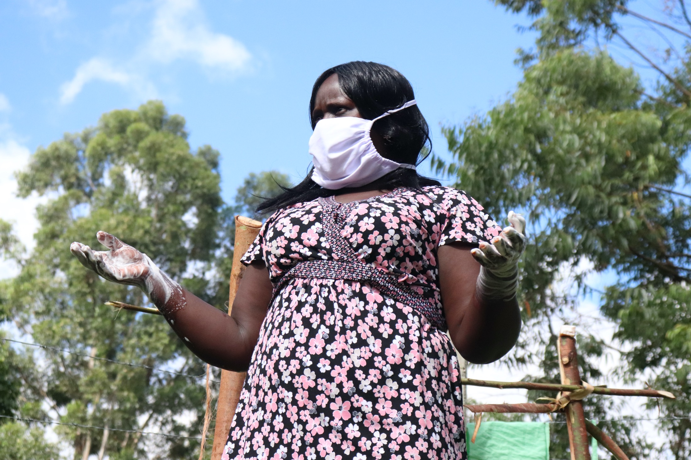 The Water Project : covid19-kenya4416-ms-catherine-leading-the-handwashing-demonstration