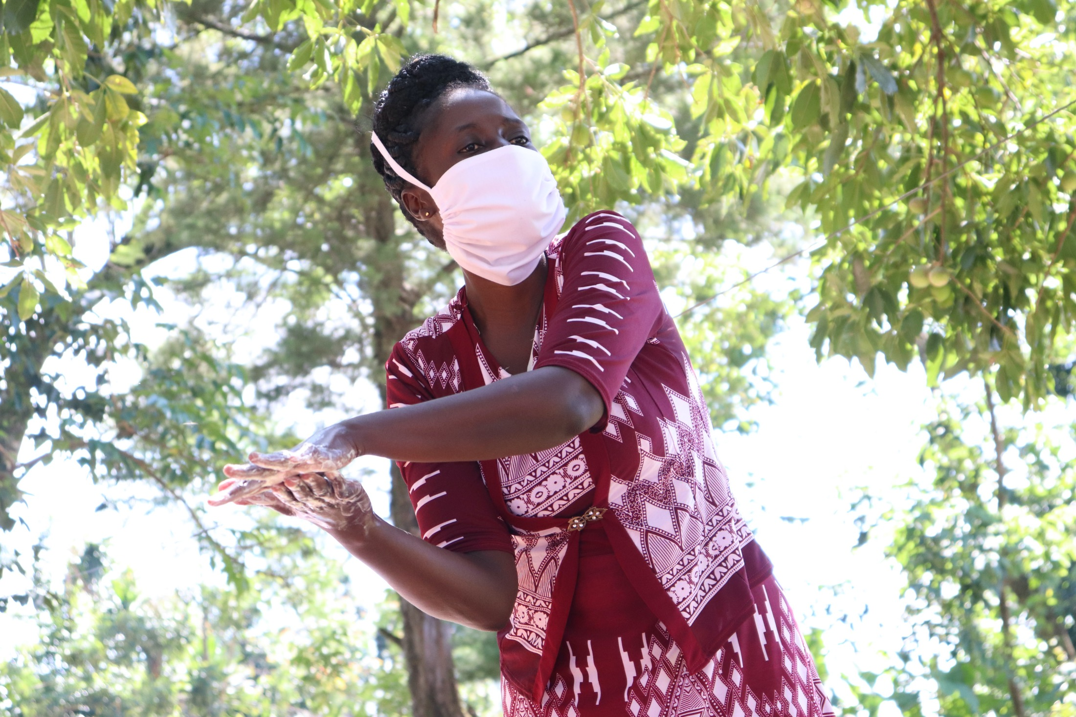 The Water Project : covid19-kenya4417-handwashing-with-soap-and-water-demonstration
