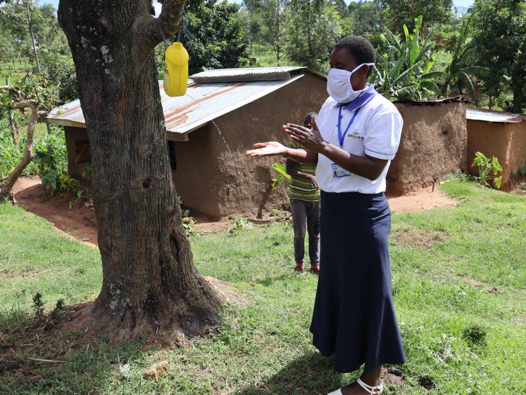 The Water Project : covid19-kenya4563-the-facilitator-demonstrating-handwashing