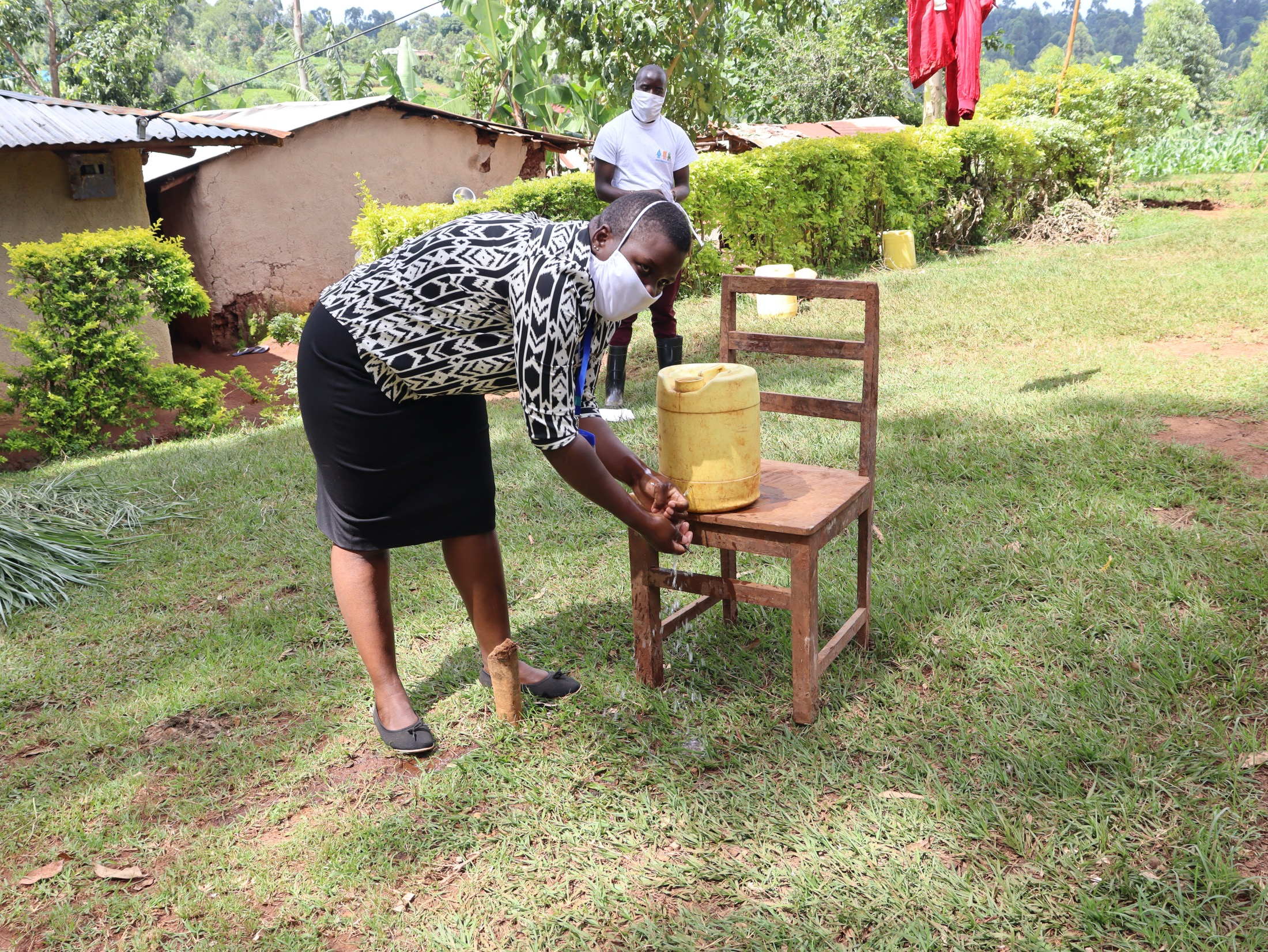 The Water Project : covid19-kenya4582-rinse-your-hands-in-clean-running-water