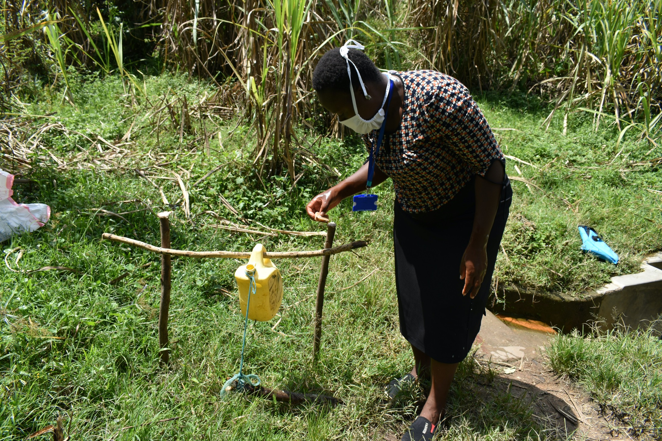 The Water Project : covid19-kenya4584-setting-up-hands-free-handwashing-station