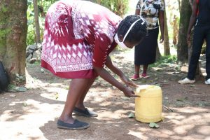 The Water Project:  Constructing A Leaky Tin Handwashing Point