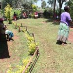 The Water Project: Mutambi Community, Kivumbi Spring -  A Community Leader Addressing The Group