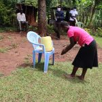 The Water Project: Mutambi Community, Kivumbi Spring -  A Community Member Demonstrating Handwashing
