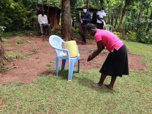 The Water Project:  A Community Member Demonstrating Handwashing