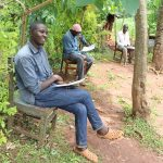 The Water Project: Mutambi Community, Kivumbi Spring -  A Community Member Listening To The Facilitator