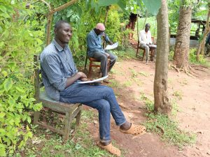 The Water Project:  A Community Member Listening To The Facilitator