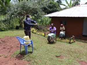 The Water Project:  The Facilitator Demonstrating The Ten Steps Of Handwashing