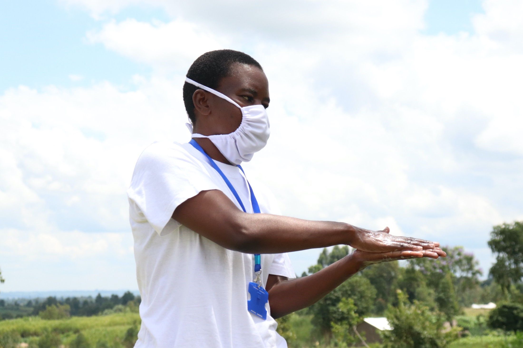 The Water Project : covid19-kenya4747-the-facilitator-demonstrating-the-ten-steps-of-proper-handwashing