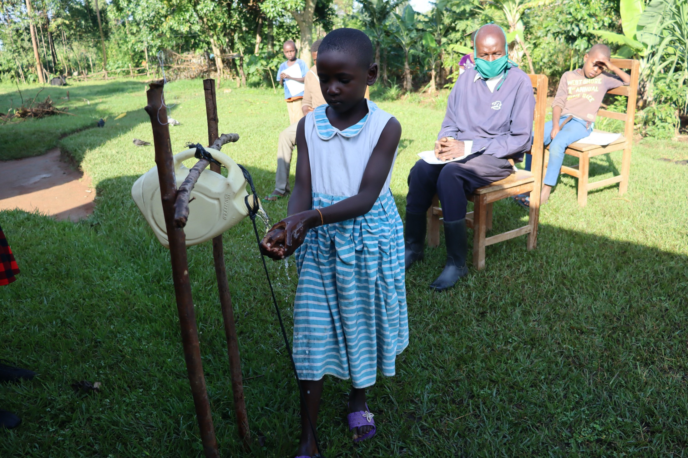 The Water Project : covid19-kenya4748-using-a-hands-free-station
