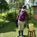 The Water Project: Mkunzulu Community, Museywa Spring -  Using A Water Jerrycan As A Handwashing Container