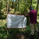 The Water Project: Elunyu Community, Saina Spring -  Installing A Reminder Chart At The Spring