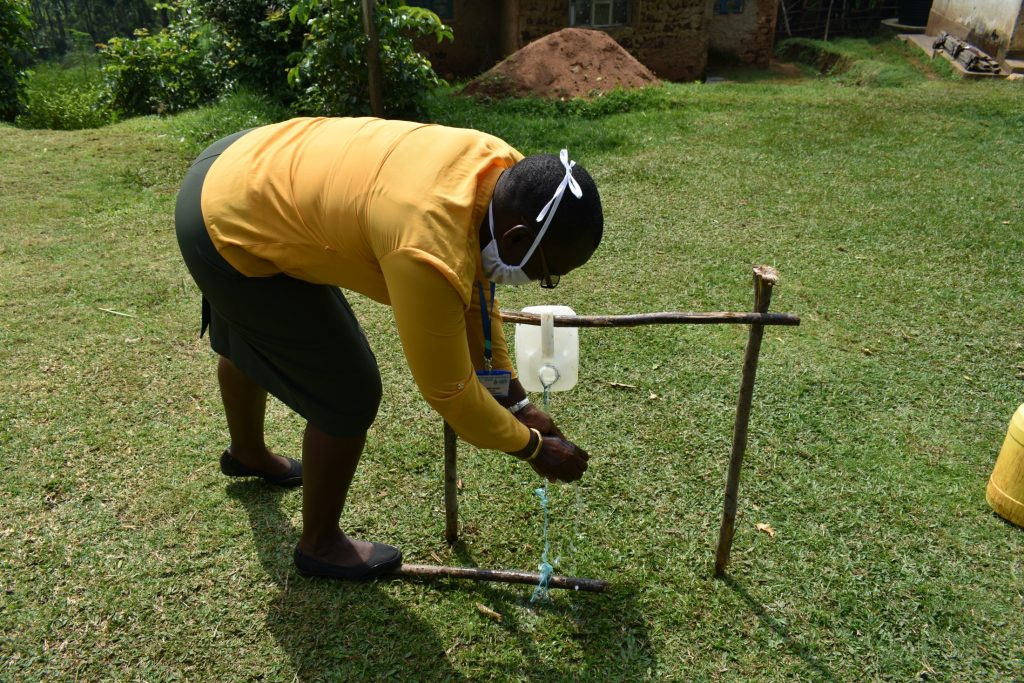 The Water Project : covid19-kenya4851-ms-janet-making-use-of-the-handwashing-station