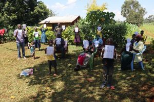 The Water Project:  Participants With Handouts Translated Into Their Local Languages
