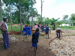 The Water Project:  Students Help Bring Materials To Schoool
