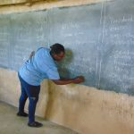 The Water Project: Bulukhombe Primary School -  Facilitator Patience Writing On Board