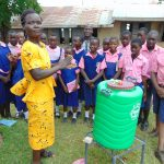 The Water Project: Bulukhombe Primary School -  A Teacher Joins The Handwashing Demonstration