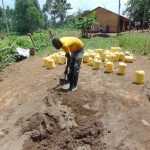 The Water Project: Bulukhombe Primary School -  Mixing Cement