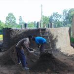 The Water Project: Bulukhombe Primary School -  Outside Tank Plastering