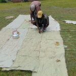 The Water Project: Bulukhombe Primary School -  Sewing Sacks To Wire For Dome Skeleton