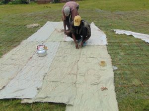 The Water Project:  Sewing Sacks To Wire For Dome Skeleton