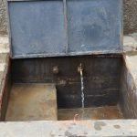 The Water Project: Bulukhombe Primary School -  Water Flowing From Rain Tank Tap