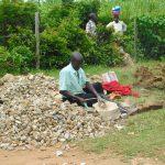 The Water Project: Mukoko Baptist Primary School -  Breaking Stones Into Gravel
