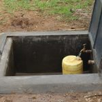 The Water Project: Mukoko Baptist Primary School -  Water Flowing From The Rain Tank