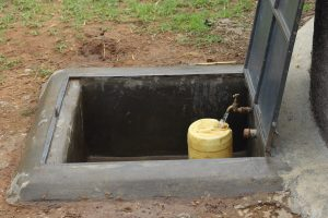 The Water Project:  Water Flowing From The Rain Tank