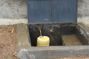 The Water Project:  Water Flowing Rom The Rain Tank