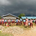 The Water Project: Mukoko Baptist Primary School -  Students Help Deliver Stones Before Schools Closed