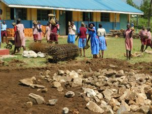 The Water Project:  Filling The Excavated Foundation With Stones