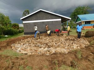 The Water Project:  Filling The Excavated Foundation With Hardcore