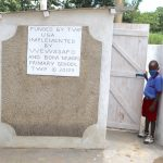 The Water Project: Mukoko Baptist Primary School -  A Pupil At The Boys Latrines