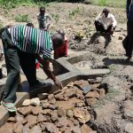 The Water Project: Mukhonje Community, Mausi Spring -  Stone Backfilling