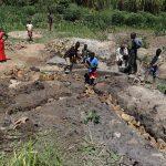 The Water Project: Mukhonje Community, Mausi Spring -  Stone Backfilling