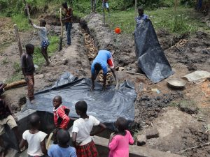 The Water Project:  Polythene Tarp Backfilling