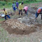The Water Project: Mukhonje Community, Mausi Spring -  Community Members Mixing The Mortar