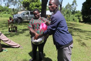 The Water Project:  Facilitator Demonstrating Handwashing