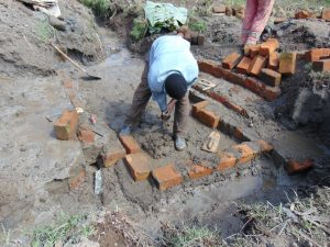 The Water Project:  Bricks Setting