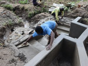 The Water Project:  Staircase Plastering