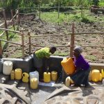 The Water Project: Mukhonje Community, Mausi Spring -  Collecting Water