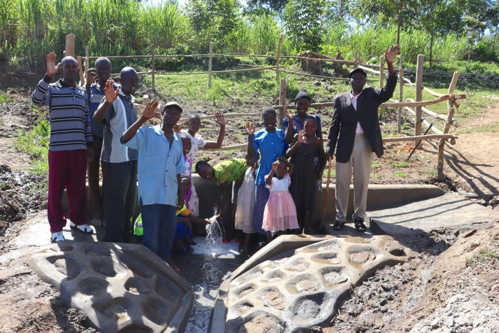 The Water Project : kenya20168-people-posing-at-the-spring-2