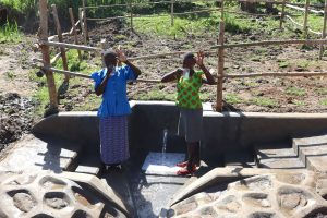The Water Project:  People Posing At The Spring