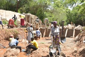 The Water Project:  Shg Members Working On The Dam