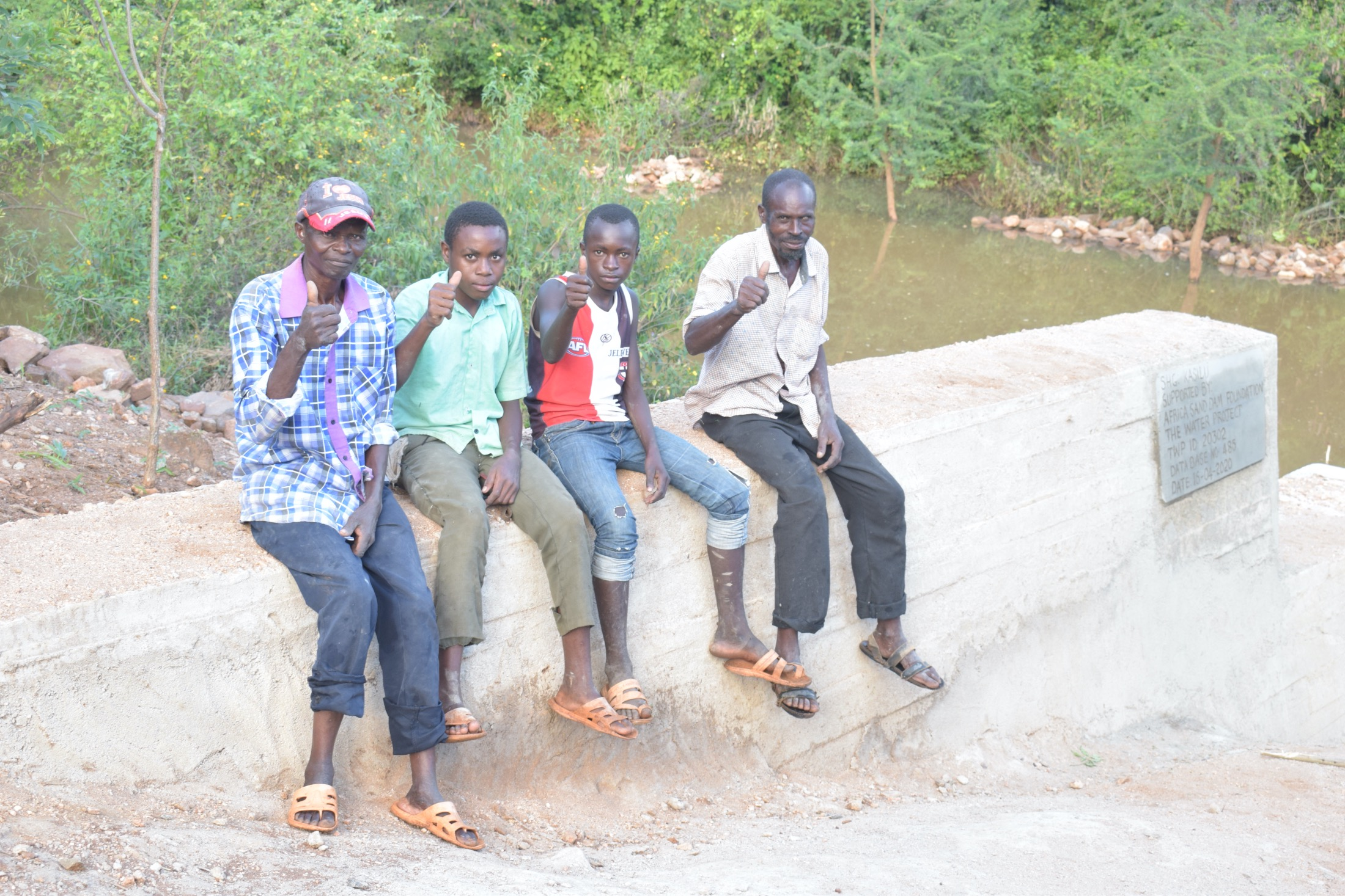 The Water Project : kenya20302-thumbs-up-for-a-new-dam