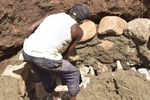 The Water Project:  Mason Builds Well Walls